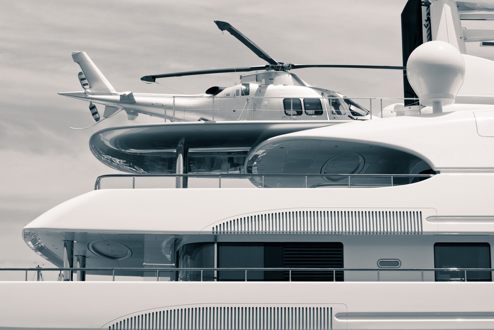 Luxury yacht with helicopter on the deck, digitally retouched and toned photo.